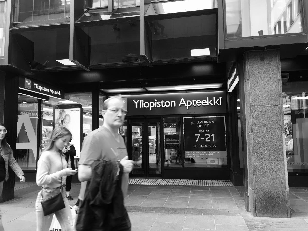 People walking by a pharmacy in Helsinki city centre