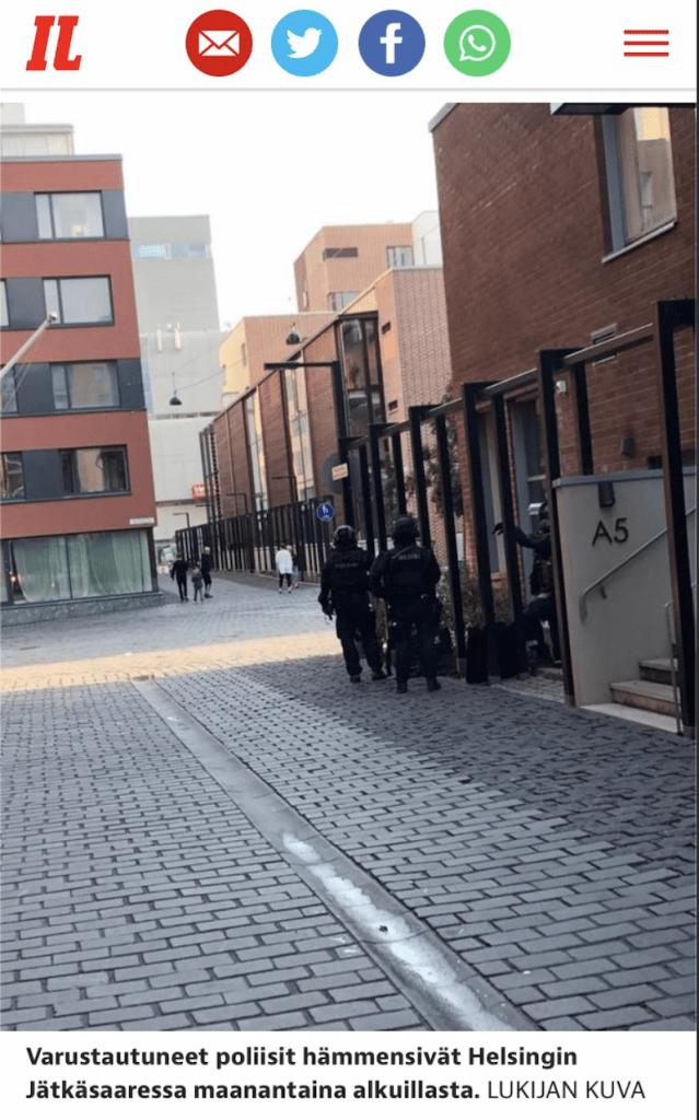 Police prepare to detain a criminal in Jätkäsaari, Helsinki.