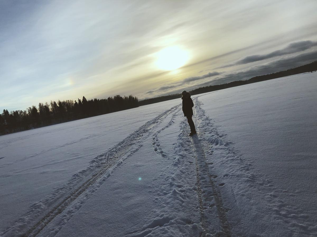 Figure in snow outside Helsinki, Finland
